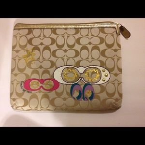Gold c's coach tablet case